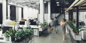 Decorative image of office space with blurred human figures